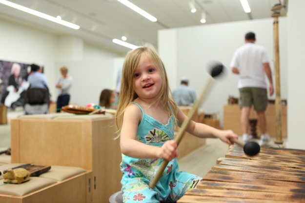 girl playing marimba