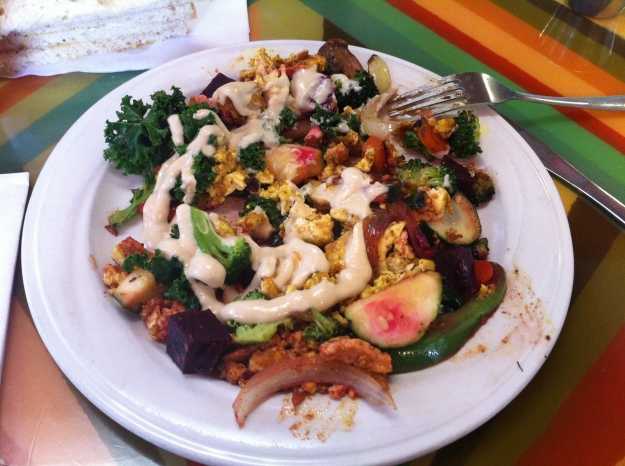 "This is the ""Good Morning Healing Earth"".  (Am I a damn hippie or what?)  :)  It consists of organic: onions, green peppers, mushrooms, zucchini, kale, broccoli, carrots, roasted beets, and scrambled tofu, then topped with tahini sauce.  It was delish!"