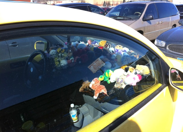 I happened to walk past this car - and literally stopped in my tracks when I saw the dash.  It is COVERED in small plush toys.  This picture doesn't do the scene justice.