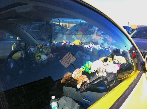 Here's a slightly different perspective.  The stuffies were at least five or six deep, and fifteen or so across.  The entire dashboard was literally COVERED in plush animals.