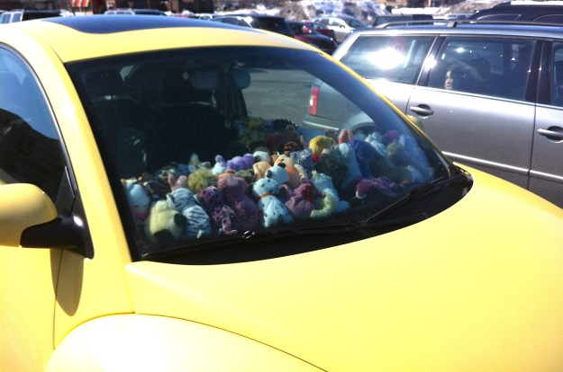 This picture shows the density of the toys on the dash.  (And as a bonus, you can see the girl looking out the window in the gray car next to this one.)