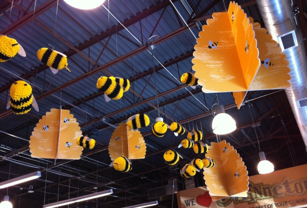 About two dozen crochet bees were hanging from the ceiling amid about 5 cardboard honeycombs. It was a fun bit of creativity and unexpectedness in what can be a routine task.  Novelty is lovely!