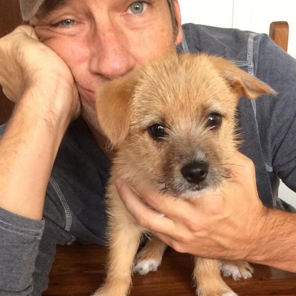 Gotta love a man with a puppy...